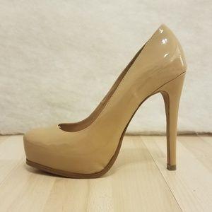 Steve Madden Stokker platform pump heels